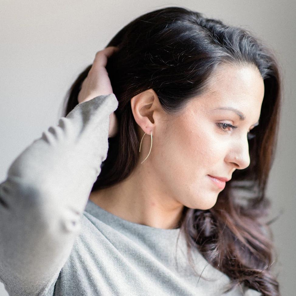 model wearing earrings