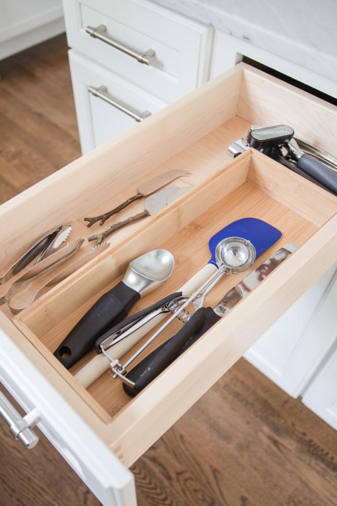white kitchen drawer with kitchen utensils inside