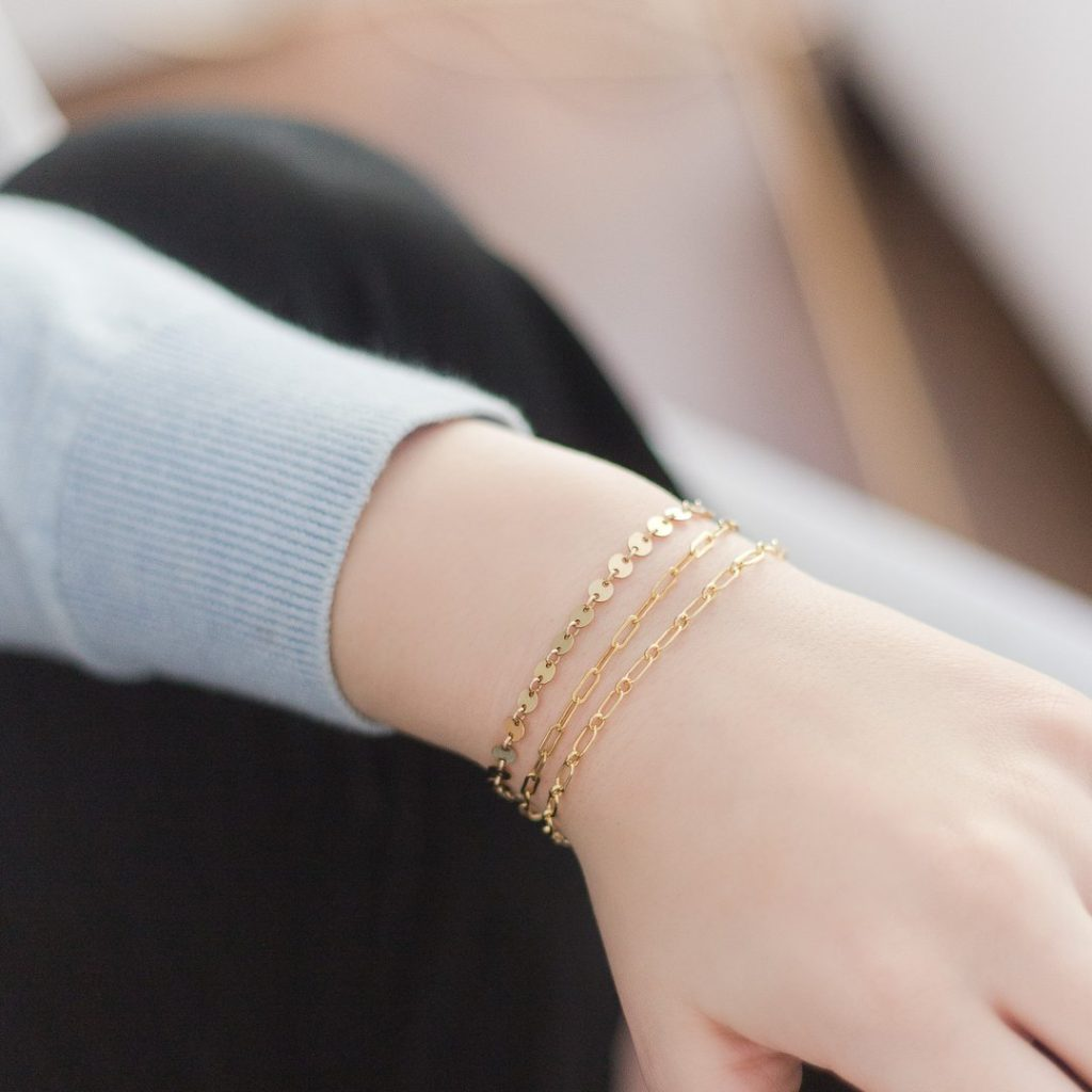 model wearing bracelets