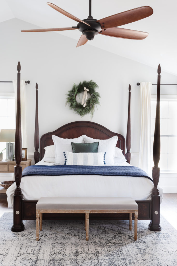 Christmas wreath above bed in bedroom