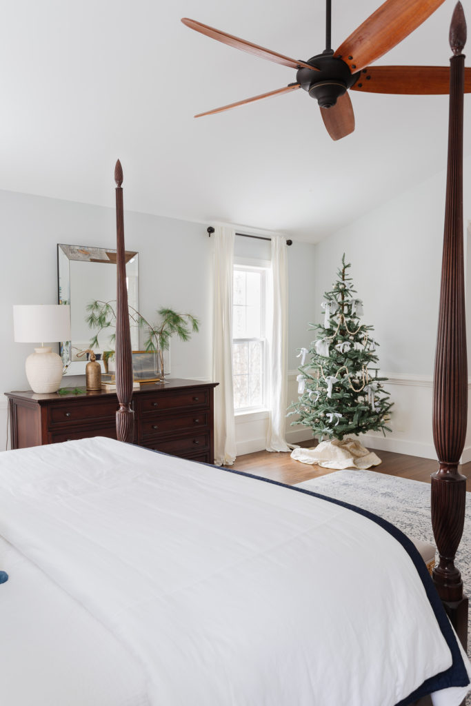 Bedroom with poster bed, dresser and Christmas tree