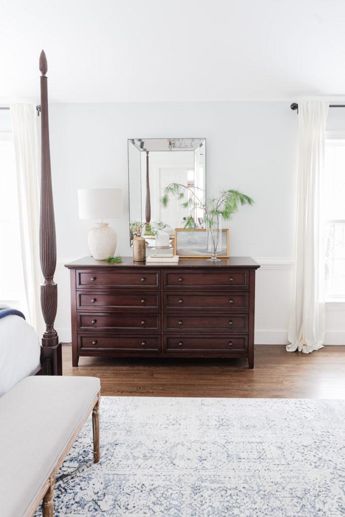 Mahogany dresser and mirror in bedroom